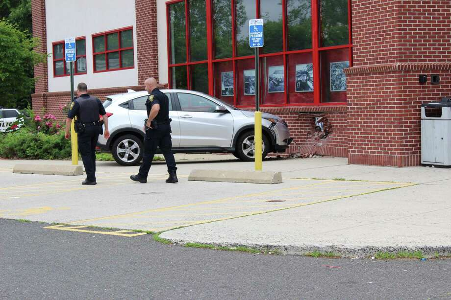 A car crashed into the CVS at 6 Willard St. on Wednesday, injuring two people. Photo: Pat Tomlinson / Hearst Connecticut Media
