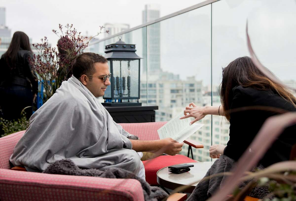 William Kasel bundles himself in a blanket while at Virgin Hotel's rooftop bar Everdene in San Francisco, Calif. Friday, June 14, 2019.