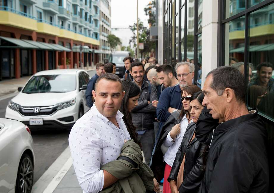 Patrons wait in a long line outside of the Virgin Hotel to access their rooftop bar Everdene in San Francisco. Photo: Jessica Christian / The Chronicle
