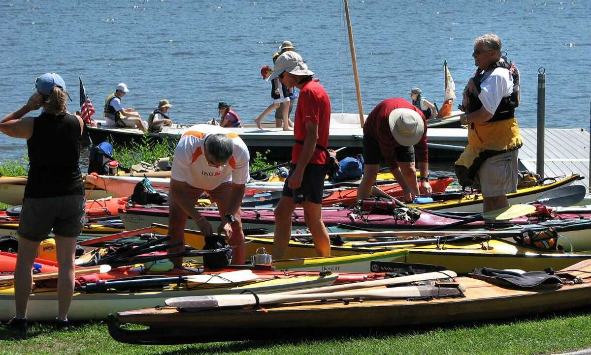 Paul Buckowski/Times Union Paddlers get ready to return to the river after a lunch break at Henry Hudson Park in Bethlehem on Thursday, the first day of the Great Hudson River Paddle. (Paul Buckowski/Times Union)