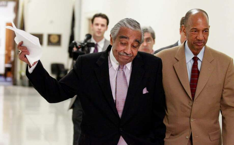 Rep. Charles Rangel, left, walks with his chief of staff George Henry as he heads for a vote on on the House floor Capitol Hill in Washington Thursday, July 29, 2010. The once-powerful Harlem Democrat faces trial on 13 ethics violations. (AP Photo/Alex Brandon) Photo: Alex Brandon / AP