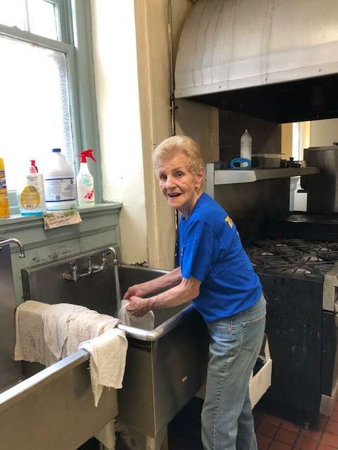 The Torrington Lions Club is helping the Community Soup Kitchen in Torrington by serving meals monthly. Above, Lion Jean Gelormino does the dishes. Photo: Contributed Photo /