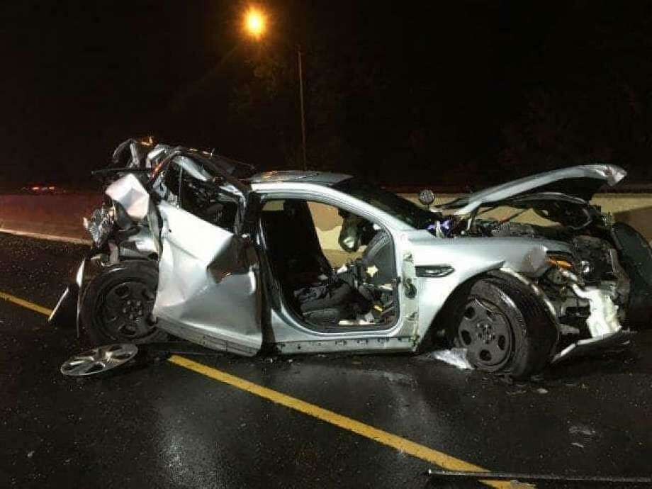 A state police trooper was seriously injured early Sunday, June 16, 2019 while three others suffered minor injuries after a car crashed into a parked cruiser in Fairfield. Photo: Contributed Photo / Connecticut State Police