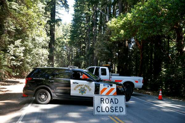 Lanes in both directions of Skyline Boulevard remain closed between Reid's Roost and Swett roads west of Woodside, Calif. on Wednesday, June 19, 2019 while investigators from the San Mateo County Sheriff's Office gather evidence from a crime scene where two men were stabbed to death.