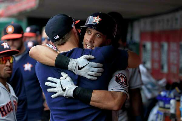 CINCINNATI, OHIO - JUNE 19: Michael Brantley #23 of the Houston Astros celebrates with a teammate after hitting a home run in the sixth inning against the Cincinnati Reds at Great American Ball Park on June 19, 2019 in Cincinnati, Ohio.