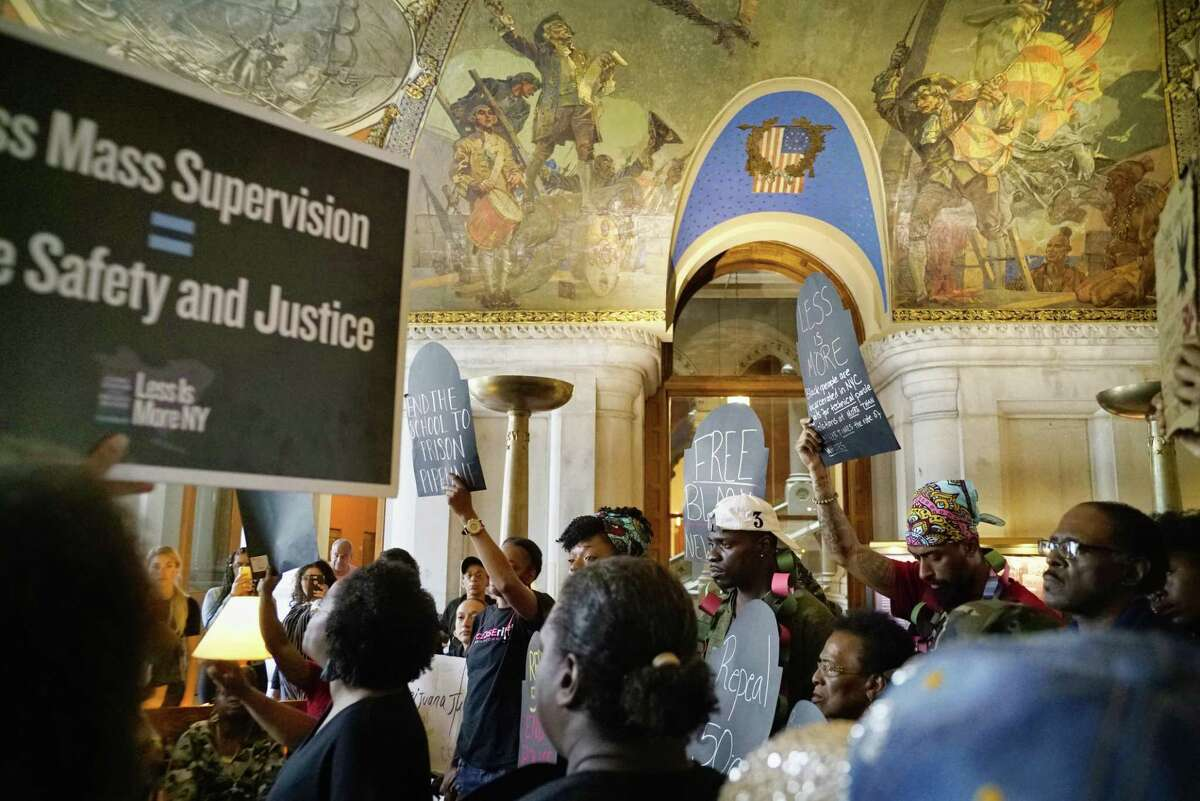 Advocates for civil justice and racial equality along with members of criminal justice organizations, take part in a rally in the War Room of the Capitol on Wednesday, June 19, 2019, in Albany, N.Y. The groups were voicing their anger on the legislatures failure to take action on marijuana legalization, the ending of solitary confinement, police accountability and transparency, dealing with school suspensions and repealing the loitering for the purposes of engaging in prostitution law, which advocates refer to as the