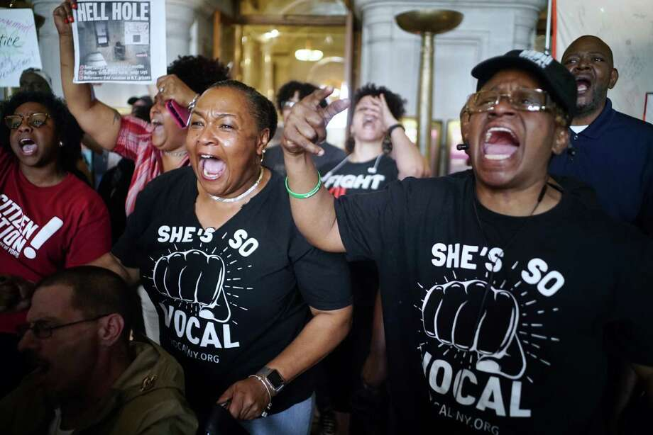 "Kim Smith, left, of Rochester, and Jovada Senhouse, of the Bronx, both members of Vocal New York, chant, ""if we don't get it, shut it down"" as advocates for civil justice and racial equality along with members of criminal justice organizations, held a rally in the War Room of the Capitol on Wednesday, June 19, 2019, in Albany, N.Y. The groups were voicing their anger on the legislatures failure to take action on marijuana legalization, the ending of solitary confinement, police accountability and transparency, dealing with school suspensions and repealing the loitering for the purposes of engaging in prostitution law, which advocates refer to as the  ""walking while trans"" law, because advocates say that transgender people are often targeted under the law because of their appearance.   (Paul Buckowski/Times Union) Photo: Paul Buckowski, Albany Times Union / (Paul Buckowski/Times Union)"