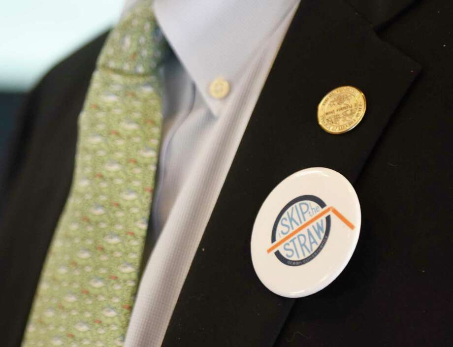 "Norwalk Common Council President Tom Livingston wears a ""Skip the Straw"" pin during an Earth Day initiative press conference at the Martime Aquarium in Norwalk, Conn. Monday, April 22, 2019. Stamford and Norwalk leaders announced a plan to ban the use of single-use plastic straws and urged local businesses and residents to use more eco-friendly materials when possible. Photo: Tyler Sizemore / Hearst Connecticut Media / Greenwich Time"