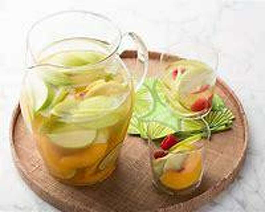 Refresh yourself with a creative white sangria laced with some vodka, tonic water, and mint! Photo: Photo Courtesy Ron Saikowski