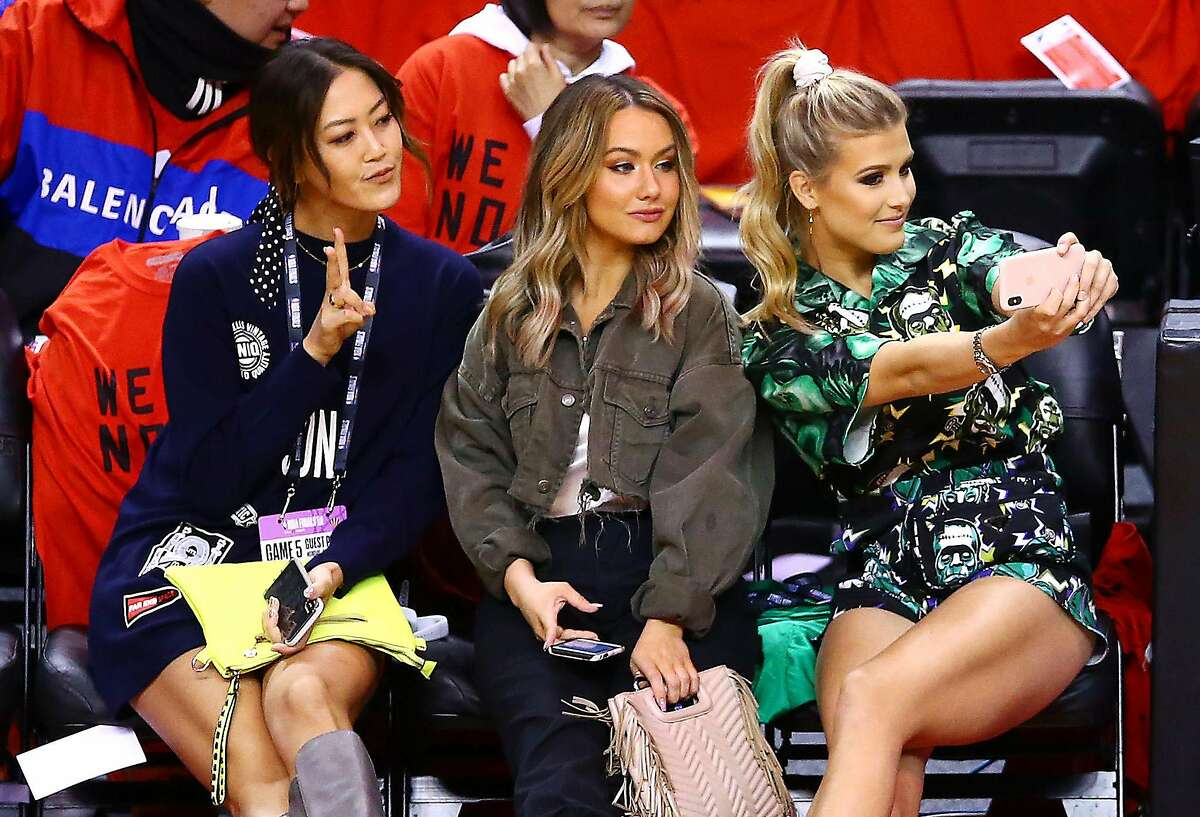 TORONTO, ONTARIO - JUNE 10: Golfer Michelle Wie, Celeste Bouchard and tennis player Eugenie Bouchard attend Game Five of the 2019 NBA Finals between the Golden State Warriors and the Toronto Raptors at Scotiabank Arena on June 10, 2019 in Toronto, Canada. NOTE TO USER: User expressly acknowledges and agrees that, by downloading and or using this photograph, User is consenting to the terms and conditions of the Getty Images License Agreement. (Photo by Vaughn Ridley/Getty Images)