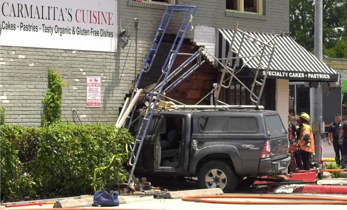 Houston firefighters work a crash where a pickup truck slammed into Carmalita's Cuiside in the 1100 block of Studewood on Wednesday, June 19, 2019.
