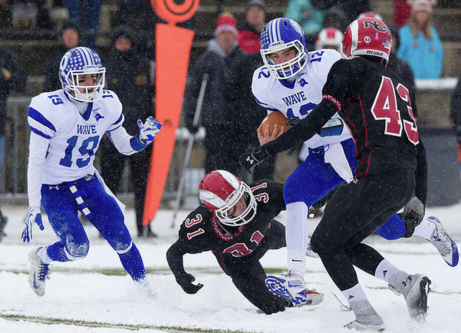 Silas Wyper (No. 12) scored both Darien TDs in the state final of 2013, the last state final played in the snow. Courtesy Darien Athletic Foundation / (c)Mark Maybell