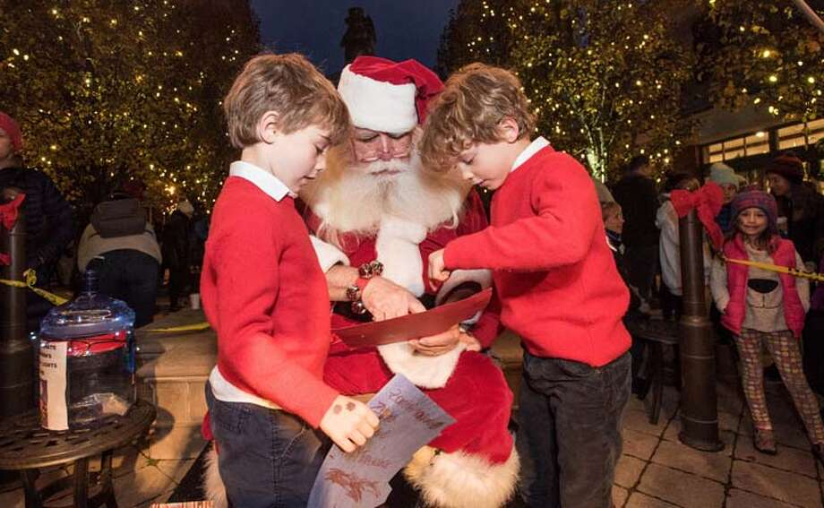 James, left, and Ryan Coyle giving Santa their list / BryanHaeffele