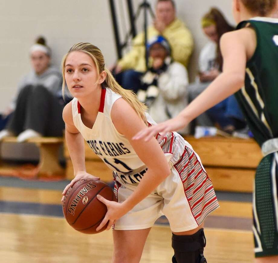 Greens Farms Academy guard Bella Litt, a resident of Darien, looks to make a pass against Chase Collegiate at the Westover Tournament.