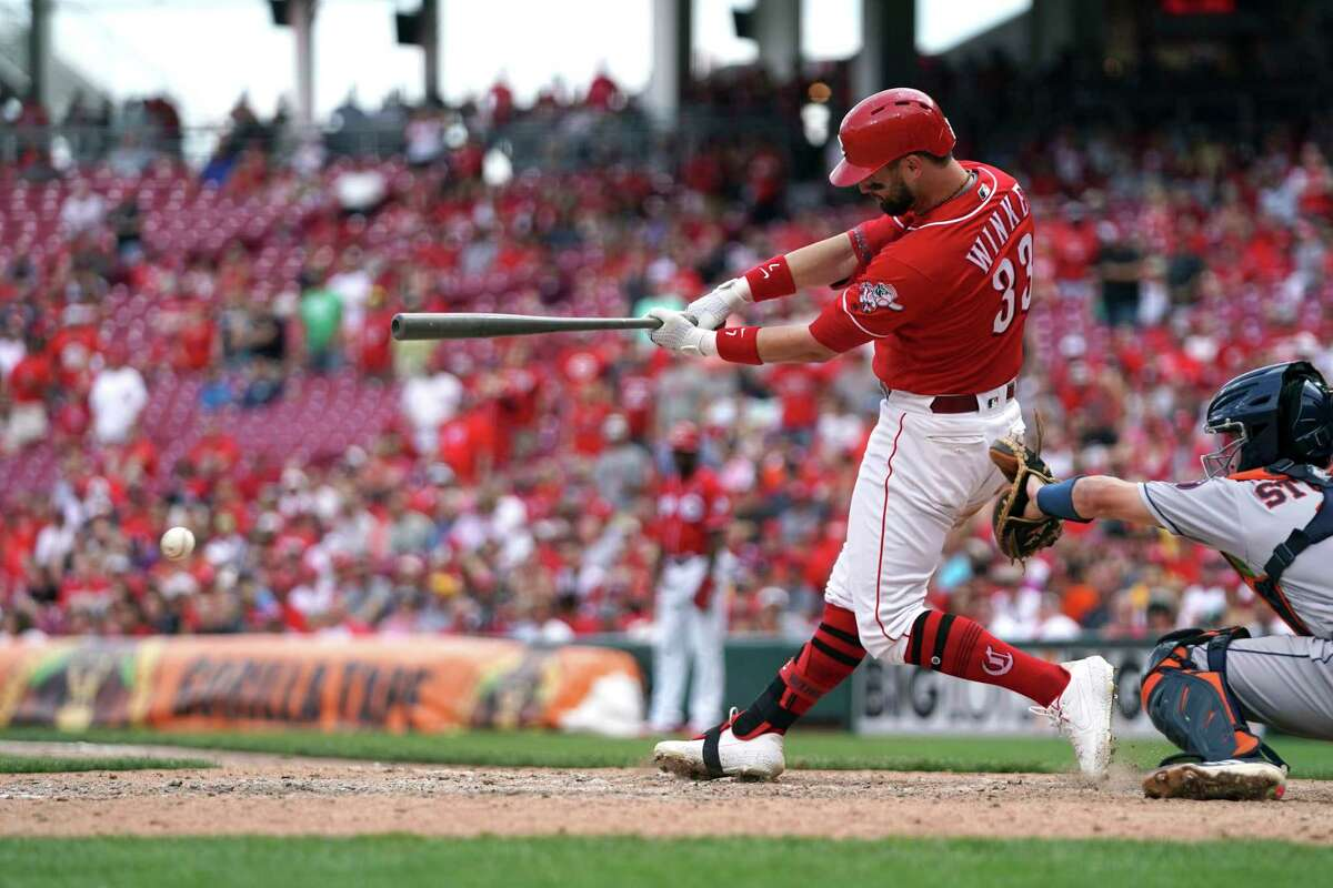 Cincinnati Reds' Jesse Winker hits the game-winning RBI-single in the ninth inning of a baseball game against the Houston Astros, Wednesday, June 19, 2019, in Cincinnati. (AP Photo/Aaron Doster)