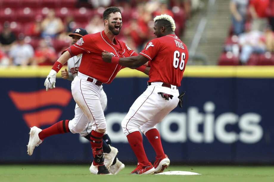 Cincinnati Reds' Jesse Winker, left, celebrates with Yasiel Puig, right, after hitting the game-winning RBI-single in the ninth inning of a baseball game against the Houston Astros, Wednesday in Cincinnati. Photo: Aaron Doster, FRE / Associated Press / Copyright 2019 The Associated Press. All rights reserved.