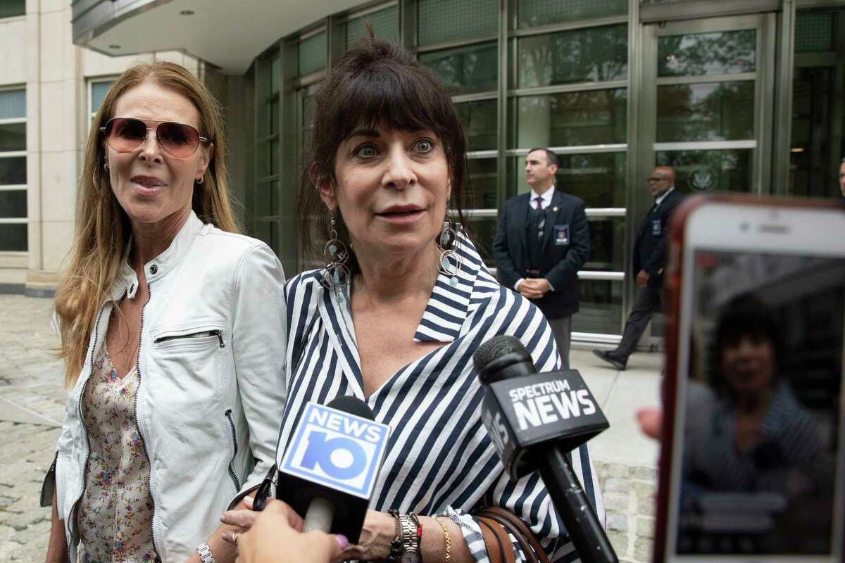 Toni Natalie, center, and Catherine Oxenberg, left, talk with the media outside Brooklyn federal court after NXIVM defendant Keith Raniere was found guilty on all counts, Wednesday, June 19, 2019 in New York. Natalie is a former Raniere girlfriend who battled the group for years after breaking with him in 1999, and Oxenberg's daughter was a member of NXIVM.
