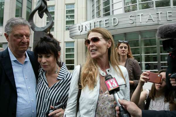 Toni Natalie, second from left, and Catherine Oxenberg talk with the media outside Brooklyn federal court after NXIVM defendant Keith Raniere was found guilty on all counts, Wednesday, June 19, 2019 in New York. Oxenberg's daughter was a member of NXIVM.