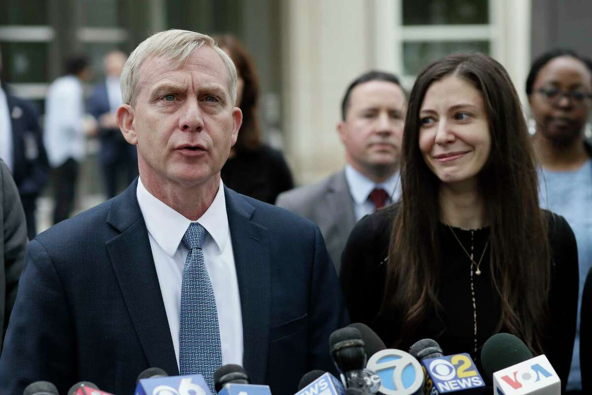 U.S. Attorney Richard Donoghue, left, talks to the media with prosecutor Moira Penza outside Brooklyn federal court after NXIVM defendant Keith Raniere was found guilty on all counts, Wednesday, June 19, 2019 in New York. A federal prosecutor said Raniere used his NXIVM organization to