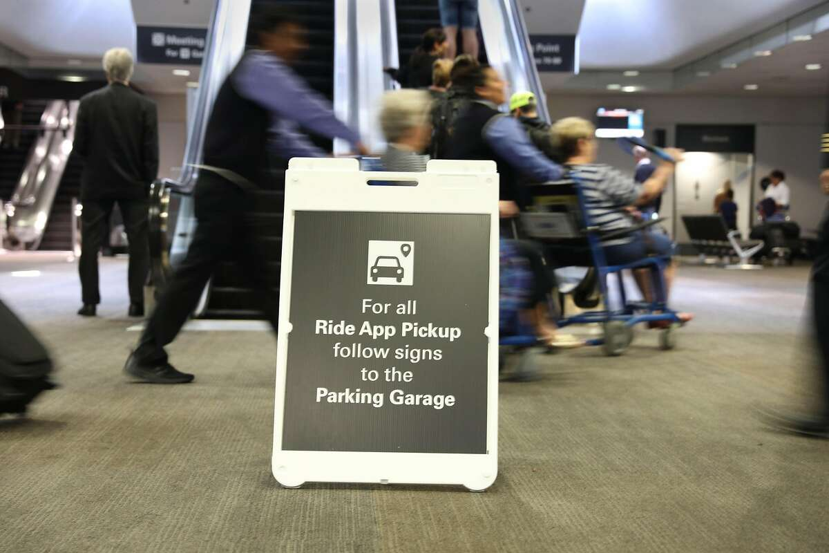 A directional sign for ride app pickup is seen at San Francisco International Airport on Wednesday, June 5, 2019 in San Francisco, Calif.