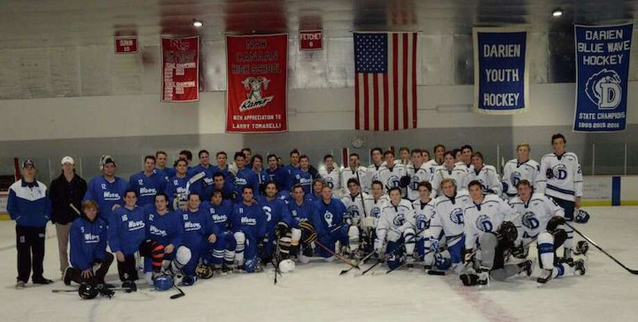 The 2016-17 team and alumni at last season's game.