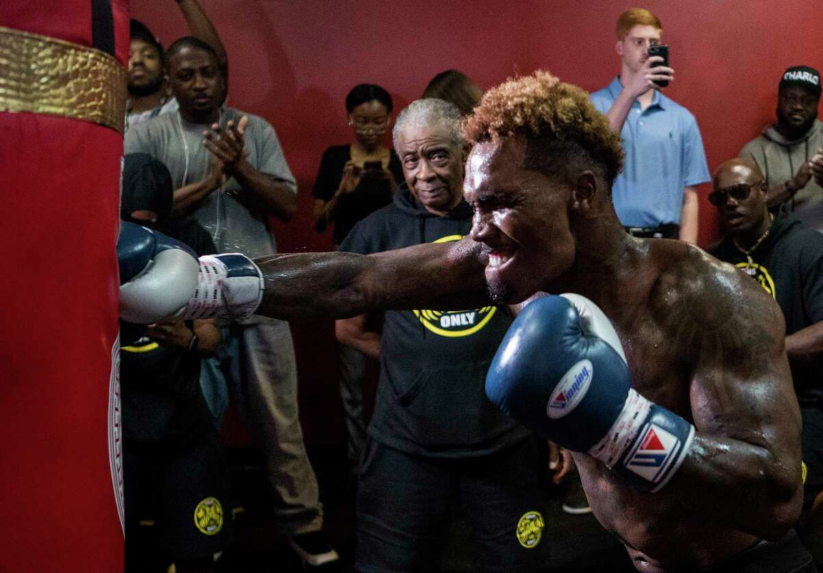 Trainer Creed Fountain, Jr., watches WBC Middleweight Champion Jermall Charlo hit the heavy bag as he works out in preparation for his upcoming fight against against Brandon Adams on Wednesday, June 19, 2019, in Houston. Charlo and Adams will face off on June 29 at NRG Arena.