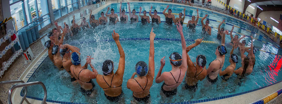 Darien rallies before a home meet in what's been a challenging year. Courtesy Darien Athletic Foundation / (c)Mark Maybell