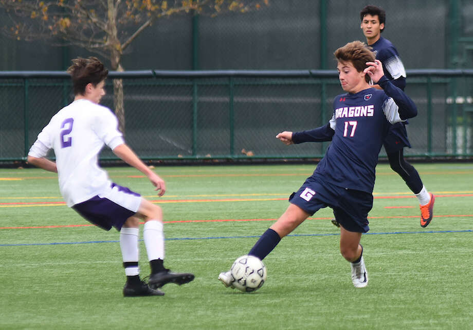GFA's Charlie Benson, right, makes a move on a Masters (NY) player during last week's FAA boys soccer semifinal in Westport.
