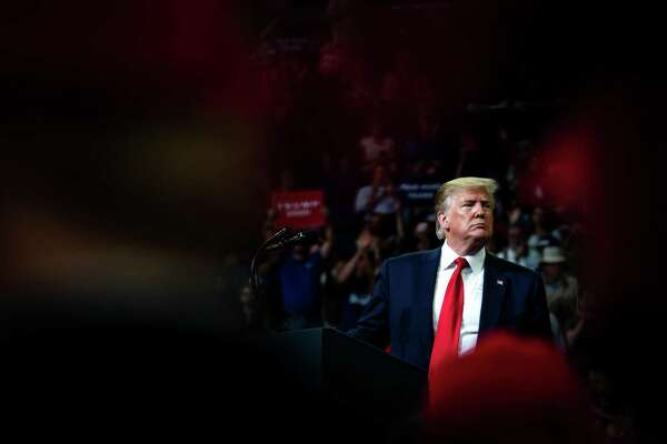 President Donald Trump is cheered by supporters at a rally in Orlando, Fla., on Tuesday night, June 18, 2019. Trump delivered a fierce denunciation of the news media, the political establishment and what he called his radical opponents on Tuesday as he opened his re-election campaign in front of a huge crowd of raucous supporters by evoking the dark messaging and personal grievances that animated his 2016 victory. (Erin Schaff/The New York Times)