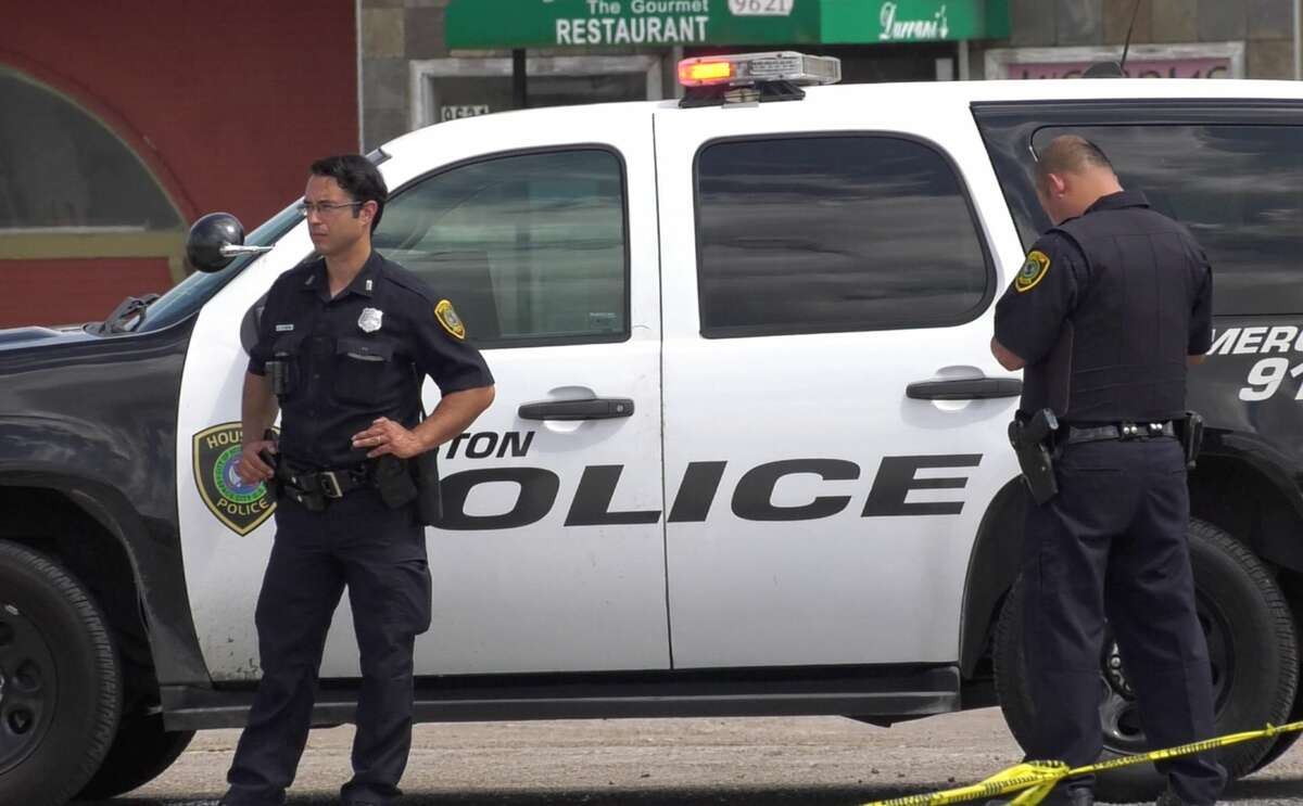 Houston police officers investigate an officer-involved shooting in the 9600 block of Bissonnet on Wednesday, June 19, 2019.