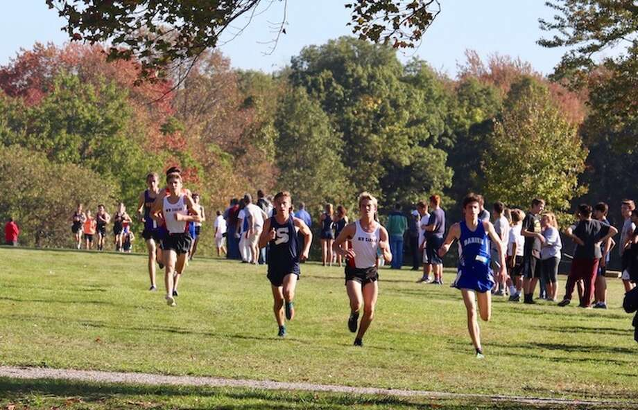 Griffin Ott (right) moves towards the line at FCIACs.