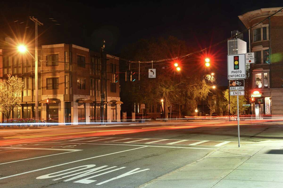 Cars pass through the intersection at Madison Avenue, Lark Street and Delaware Avenue in this long exposure photograph of the red light camera intersection. (Lori Van Buren/Times Union)