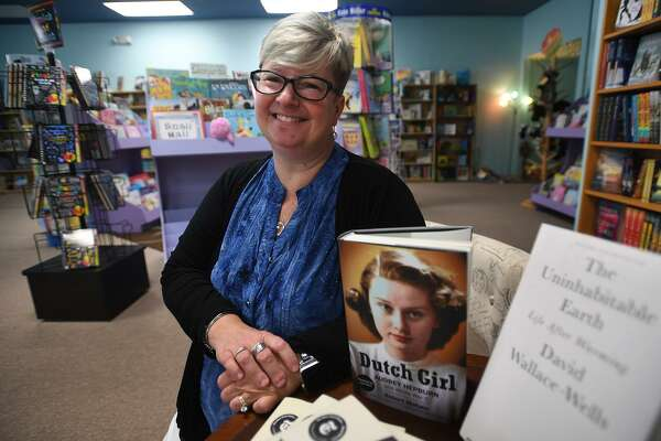 Owner Pia Ledina at the new Turning the Page bookstore at 477 Main St. in Monroe on Wednesday.