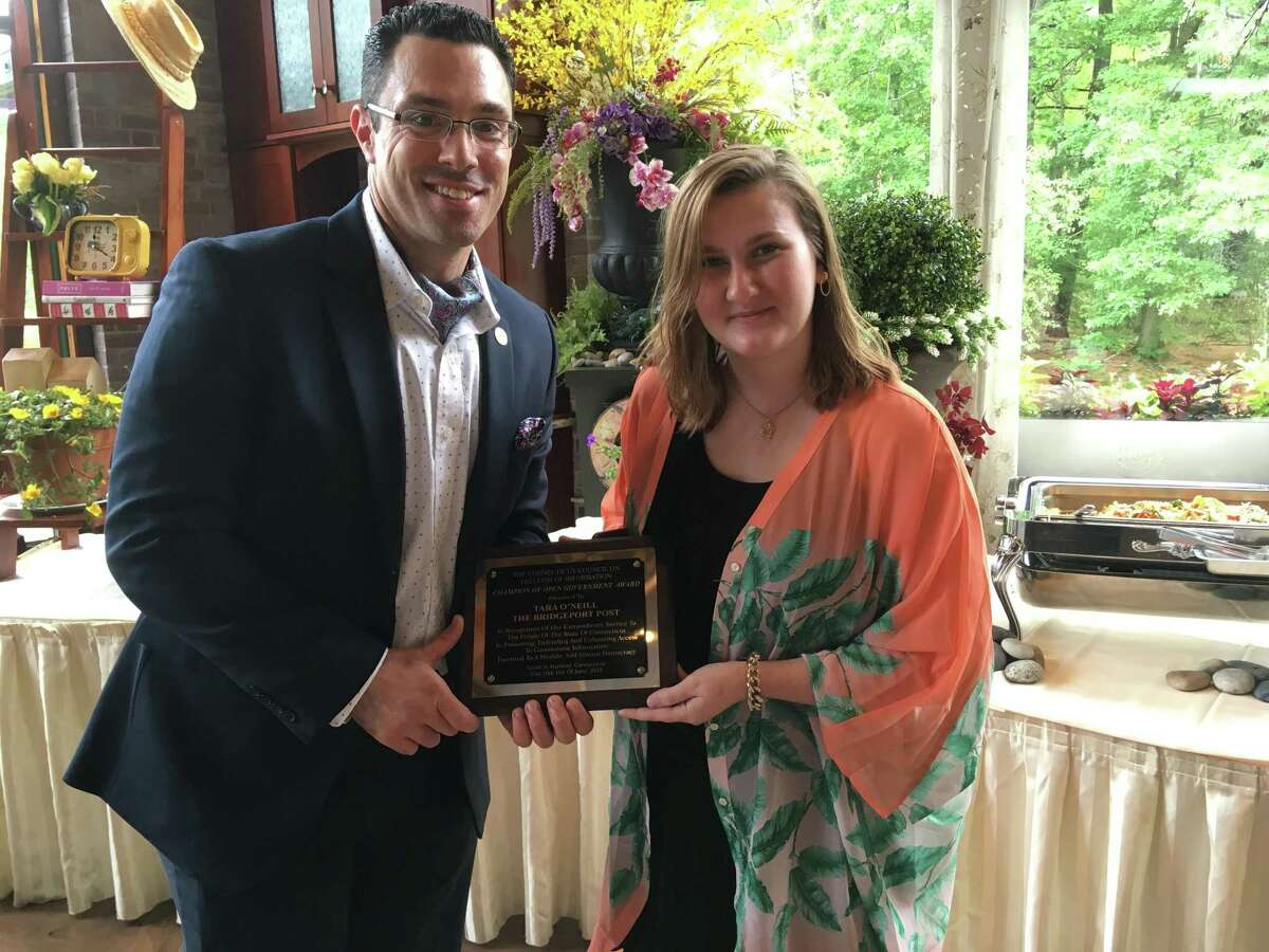CCFOI President Mike Savino with Tara O'Neill at the awards luncheon in Hartford on Wednesday.