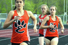 Edwardsville junior Abby Korak runs away from the competition during a meet in the regular season.