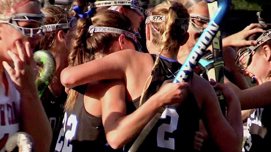 Bridget Mahoney (right) mobbed after her goal.