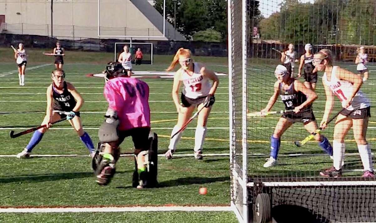 Bridget Mahoney (left) watches the ball slink towards the open net.