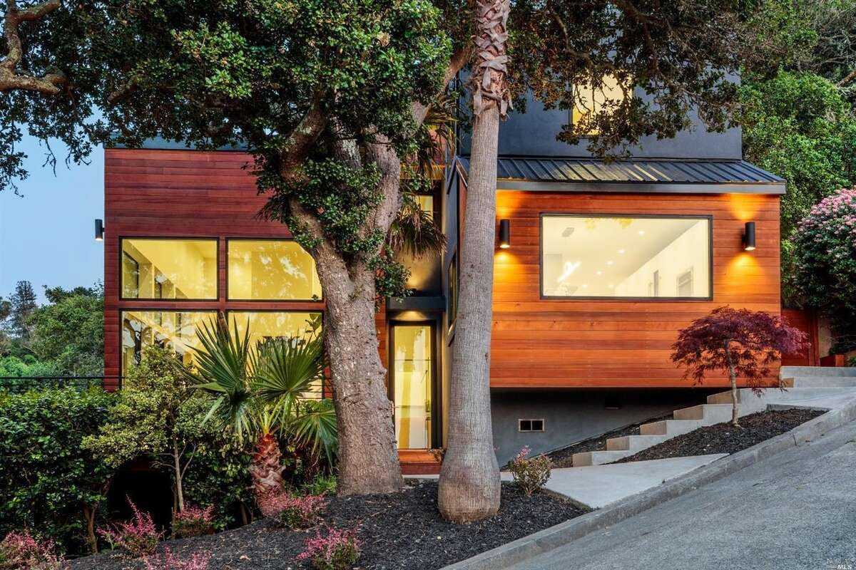 After: The developer updated the exterior with cedar siding in a dark orange stain.