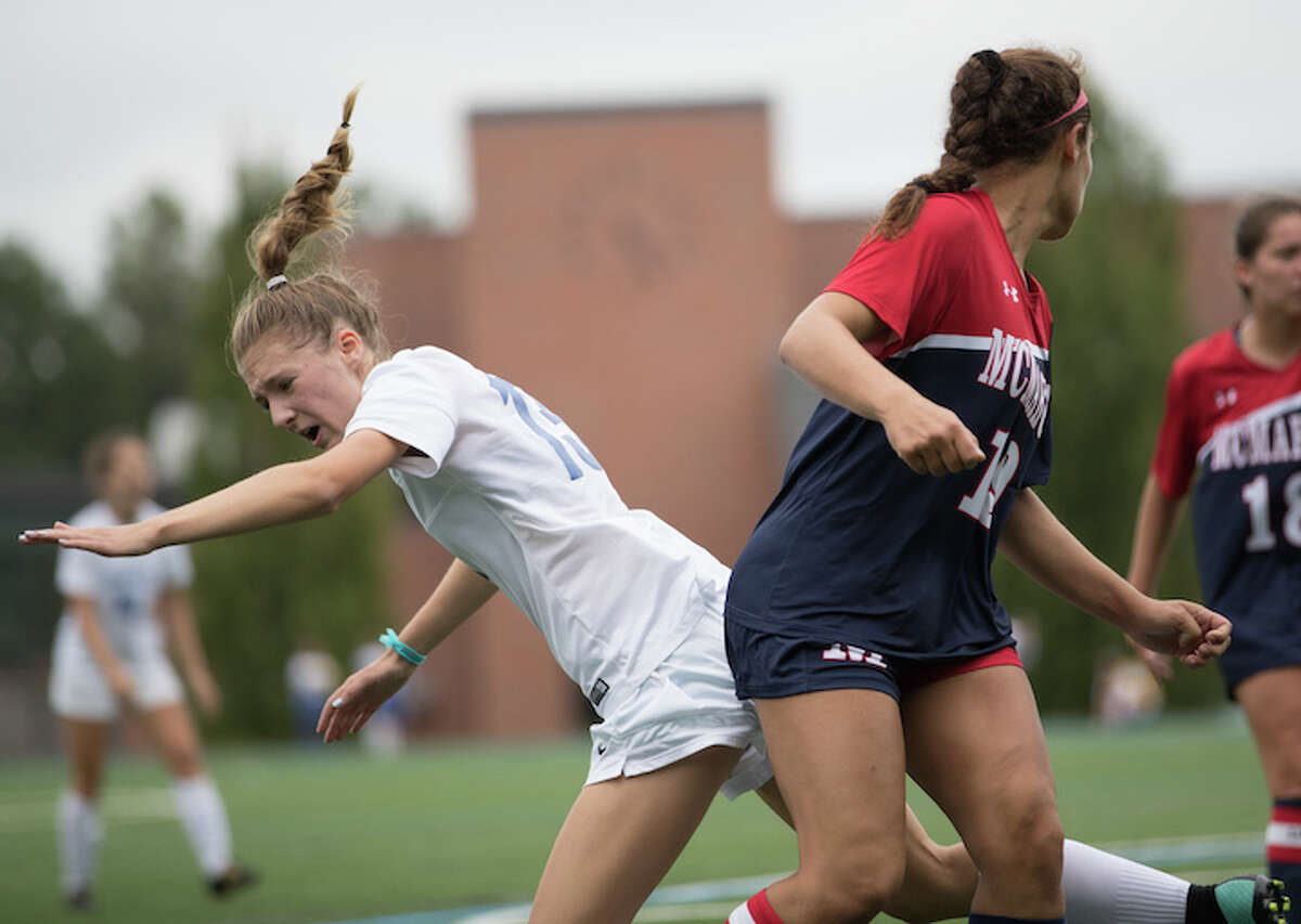 Ellen Harnisch collides with a Senator in Monday's action at home. Courtesy Darien Athletic Foundation