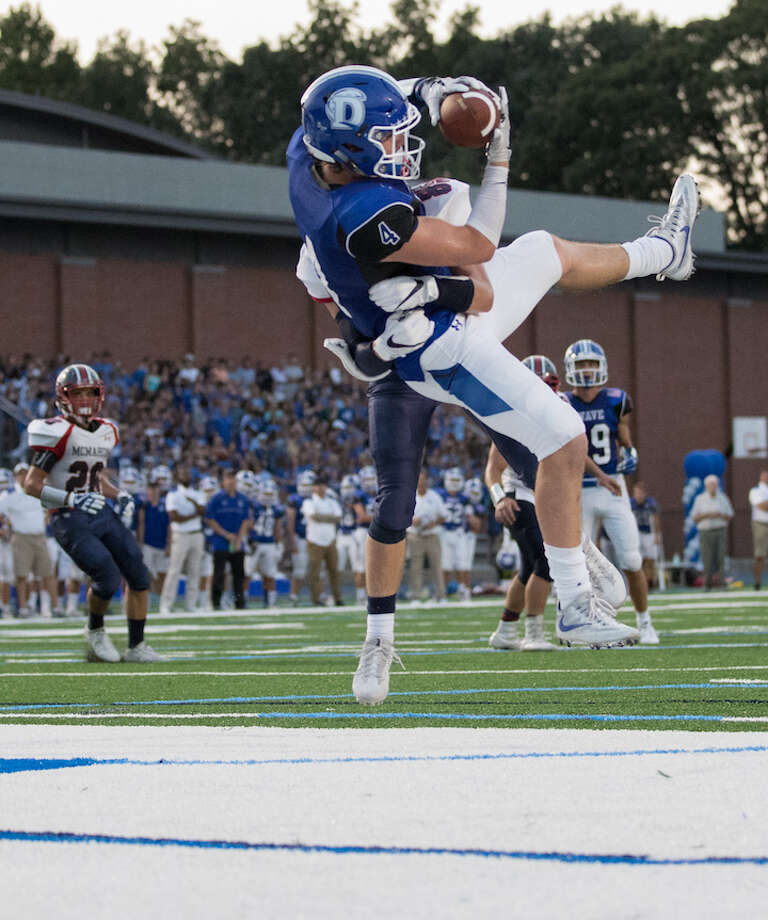 TO THE MAX — Max Grant takes to the air and takes the TD pass on Friday. Courtesy Darien Athletic Foundation / (c)Mark Maybell