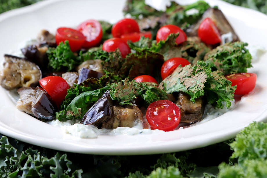 A dish featuring kale is this Roasted eggplant with crispy kale with yogurt. (Hillary Levin/St. Louis Post-Dispatch/TNS) Photo: Hillary Levin / St. Louis Post-Dispatch