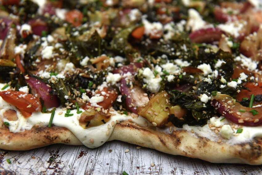 Vegetable pizza with herbs and whipped feta: feta cheese, carrots, shallots, artichoke hearts, radish and kale from Caroline Barrett on Thursday, June 13, 2019, in Delmar, N.Y. (Will Waldron/Times Union)