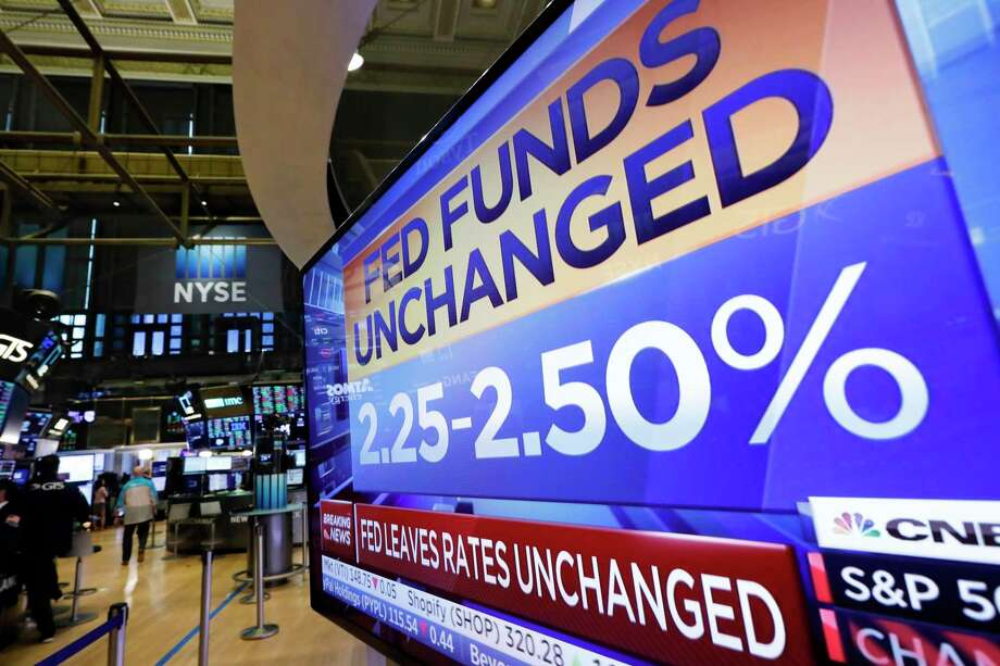A television screen on the trading floor of the New York Stock Exchange shows the rate decision of the Federal Reserve, Wednesday, June 19, 2019. The Federal Reserve is leaving its key interest rate unchanged but signaling that it's prepared to start cutting rates if needed to protect the U.S. economy from trade conflicts and other threats. (AP Photo/Richard Drew) Photo: Richard Drew / Copyright 2019 The Associated Press. All rights reserved.