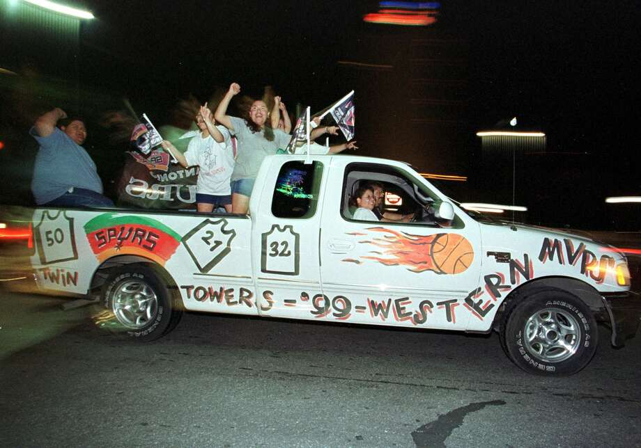 San Antonio Spurs fans drive through the streets of San Antonio 26 June, 1999, celebrating the Spurs NBA Championship. The Spurs beat the New York Knicks to win the first championship in franchise history. Photo: Paul Buck | AFP, Getty Images