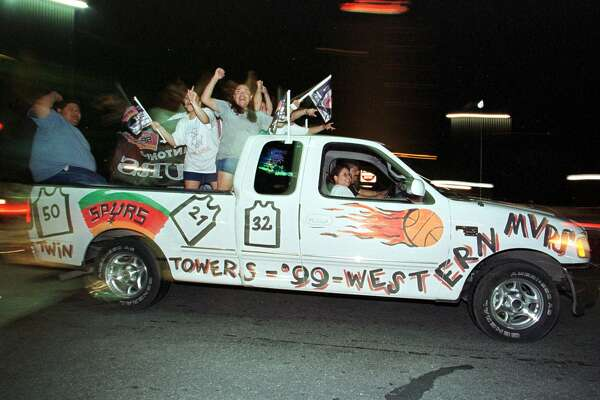 San Antonio Spurs fans drive through the streets of San Antonio 26 June, 1999, celebrating the Spurs NBA Championship. The Spurs beat the New York Knicks to win the first championship in franchise history.