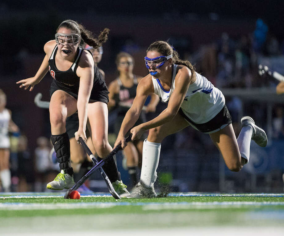 Katie Elders lunges for the ball in the season opener. Courtesy Darien Athletic Foundation / (c)Mark Maybell