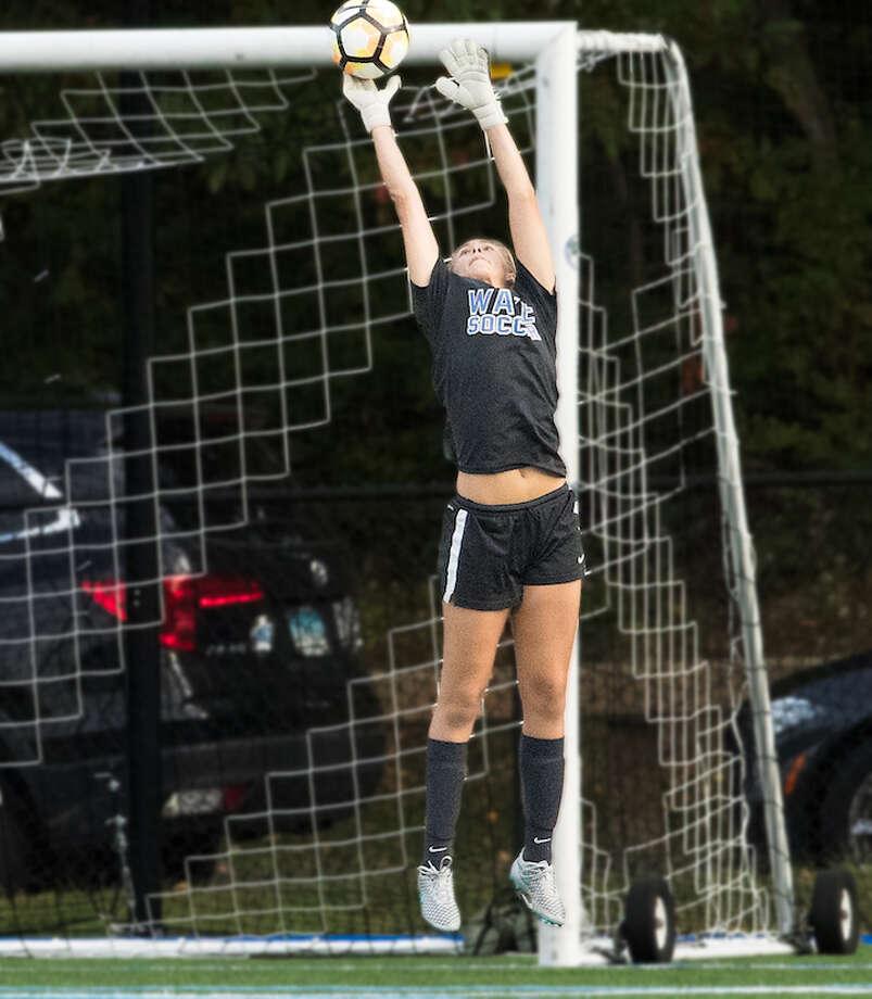 Christine Fiore rises to the occasion in goal. Courtesy Darien Athletic Foundation