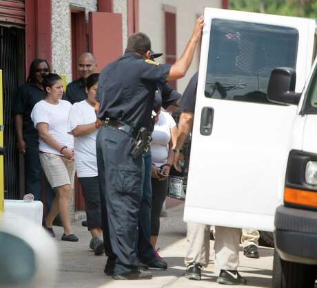 Federal agents raid a tortilla factory in the Heights, Tuesday, Aug. 4, 2015, in Houston. A message from the president this week promising millions of deportations has unnerved immigrant communities.