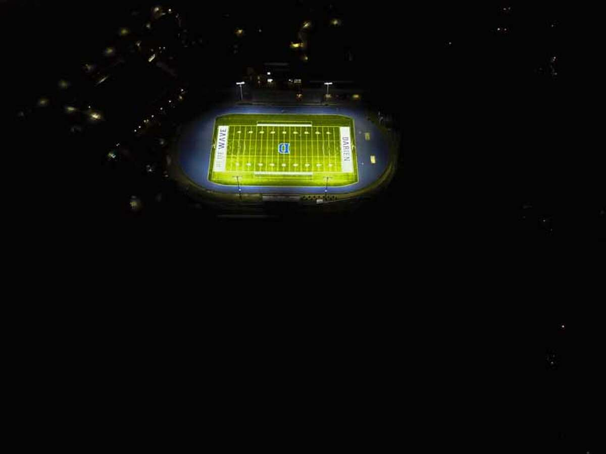 Taken from above Middlesex Road. Stadium East, in the foreground, is pitch black