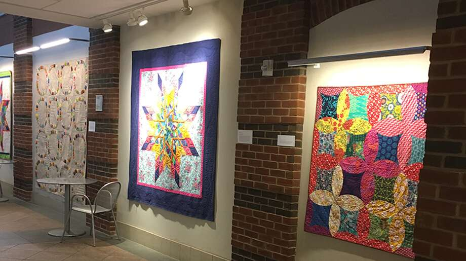 Just a handful of Lisa Mason's quilt designs, currently on display at Darien Library